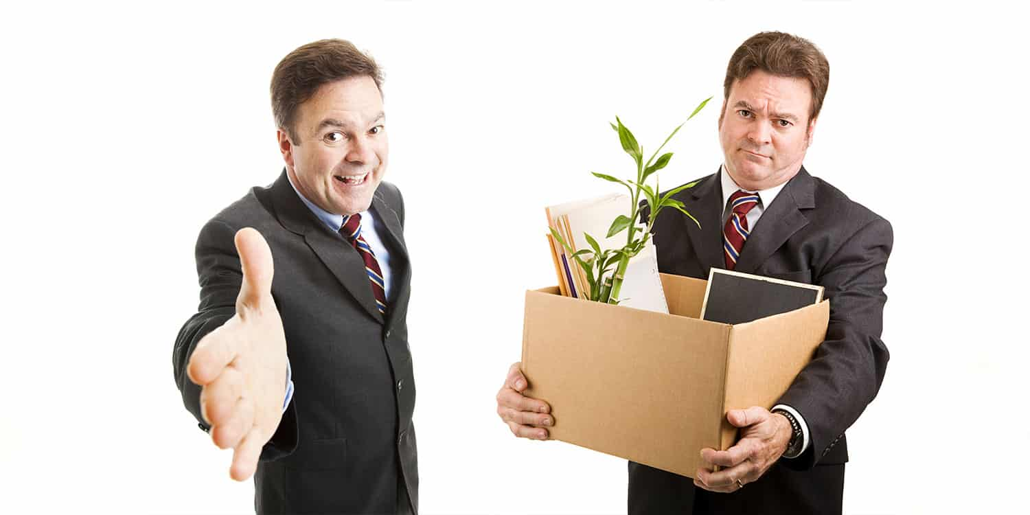 An image of one businessman displaying an introductory greeting and another one with box of personal effects - denoting the concept of appointing and removing limited company directors.