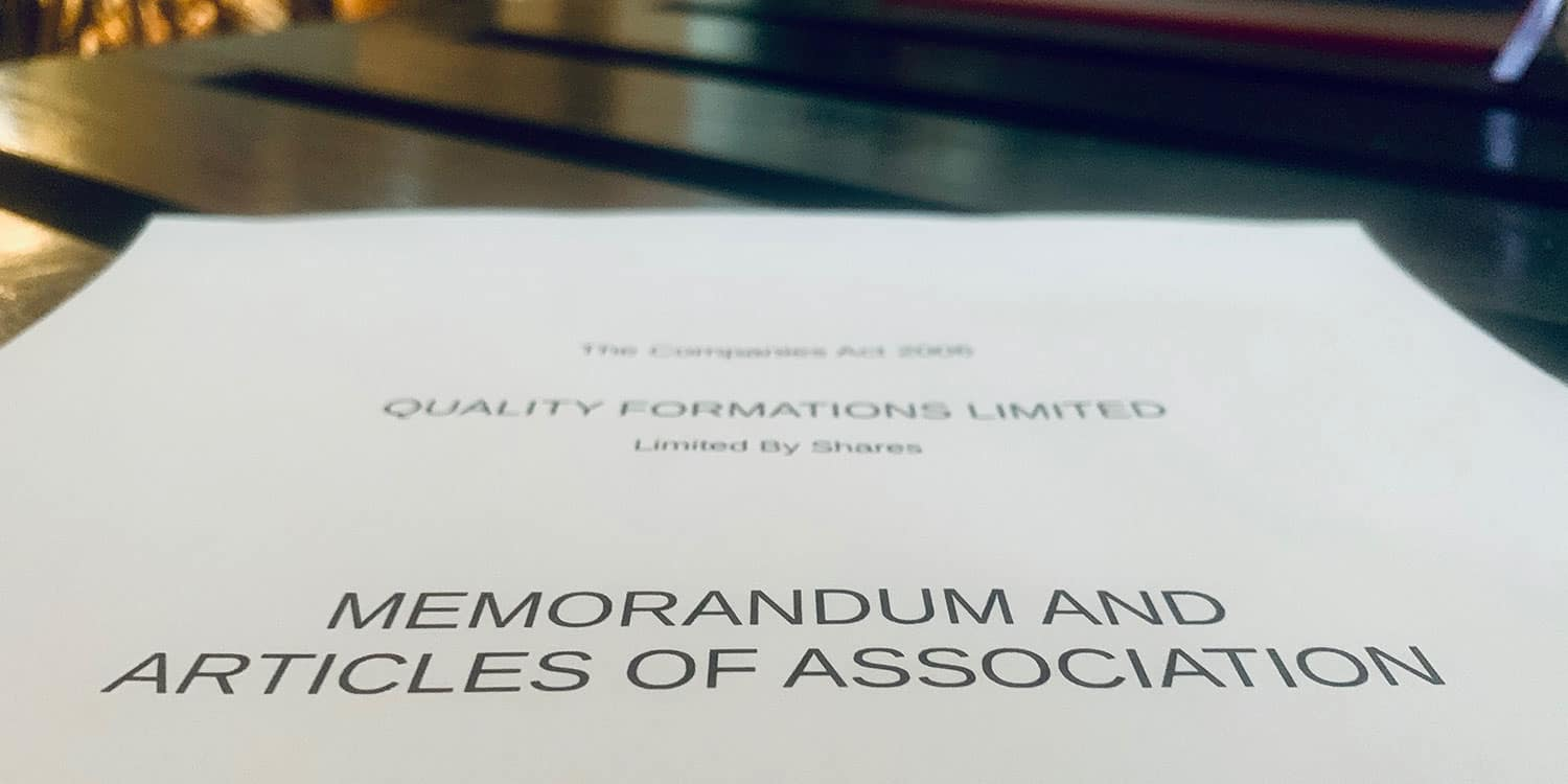 "Image showing an A4 piece of paper with the words ""Memorandum and article of association"" printed in black text."