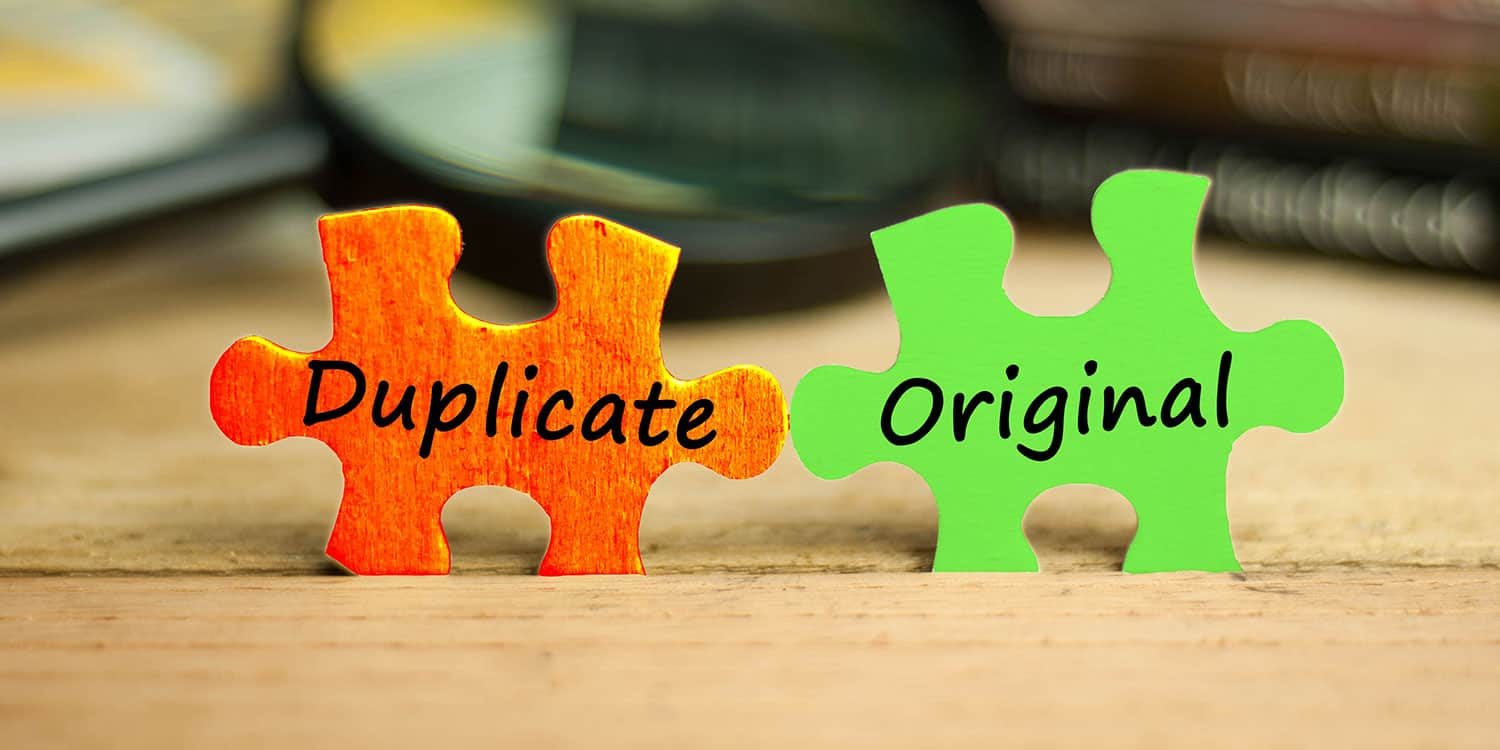 Two jigsaw pieces displaying the words 'duplicate' and 'original', illustrating the restrictions on using the same name as another company.