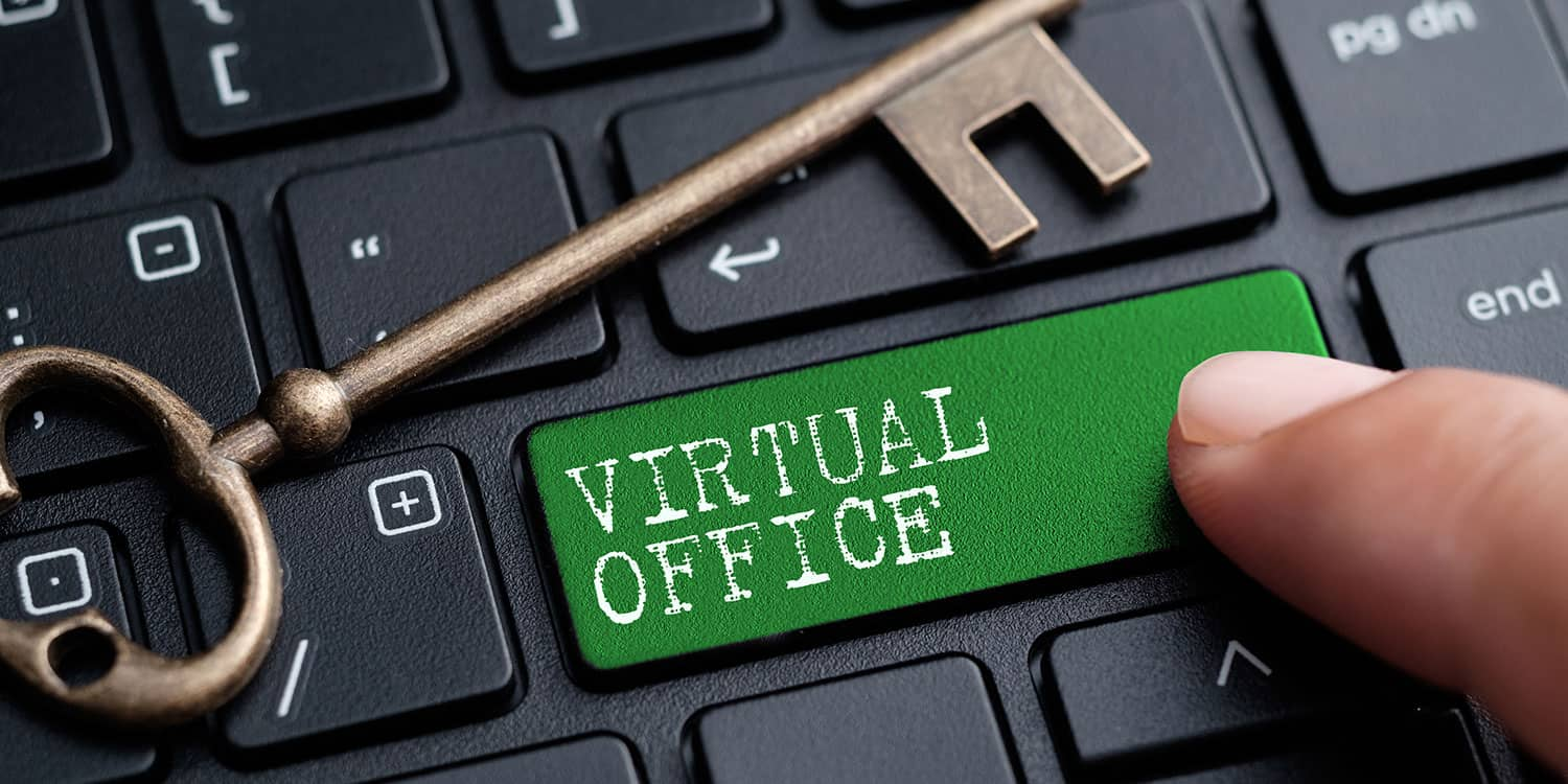 "Close-up on a computer keyboard with the words ""Virtual Office"" featured on one of the keys."