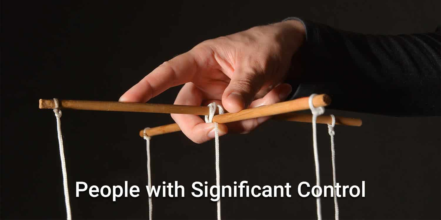 A hand holding puppet controls with the headline 'People with Significant Control'.