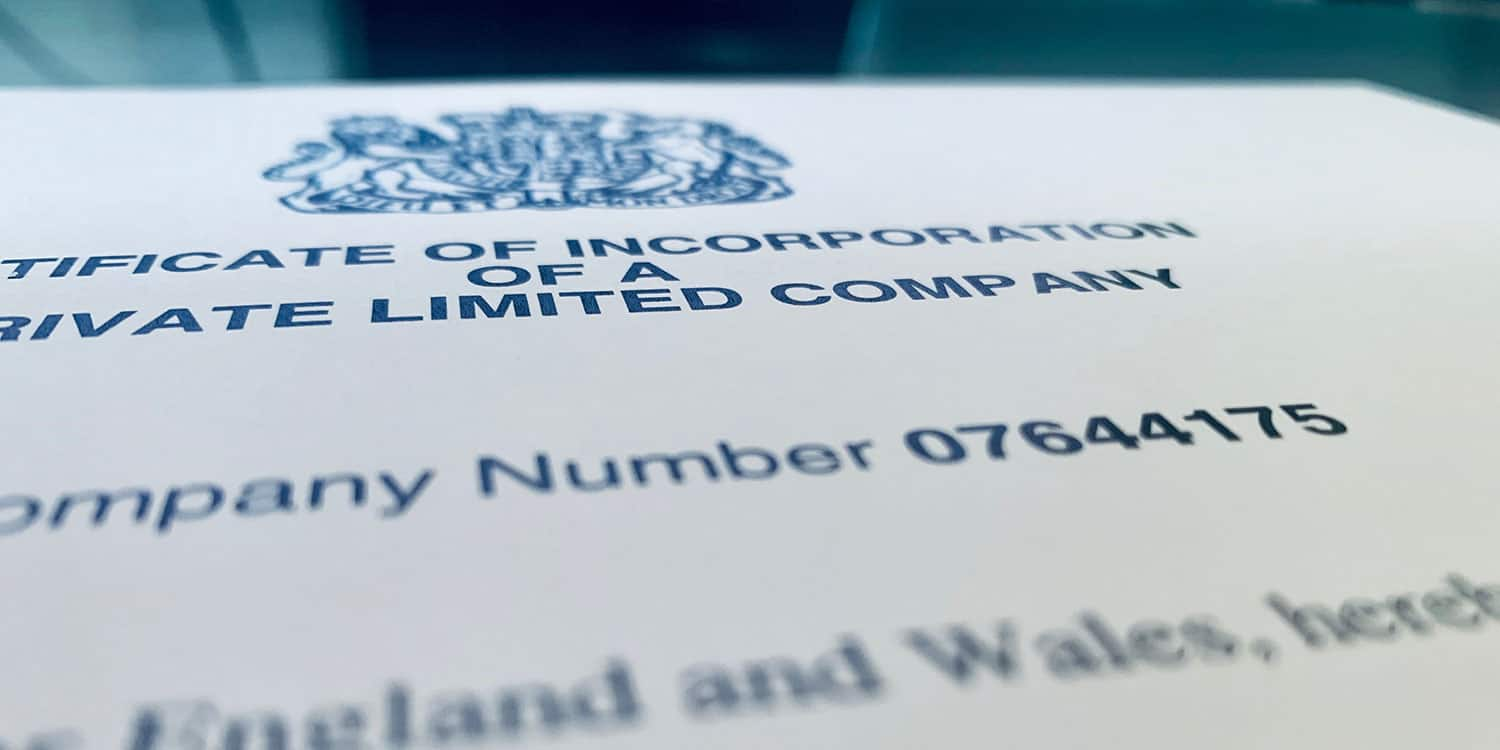 A close-up shot of a Certificate of Incorporation, focusing on the company registration number.