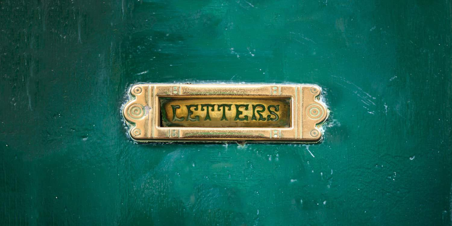 Image of a brass letter plate on a green door, illustrating the purpose of a director's service address.