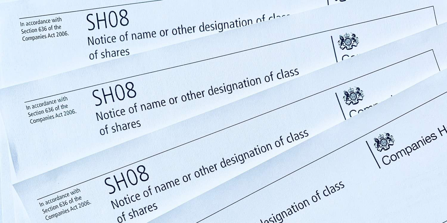 Image of printed copies of Companies House form SH08, which must be completed when a redesignation of shares is carried out.