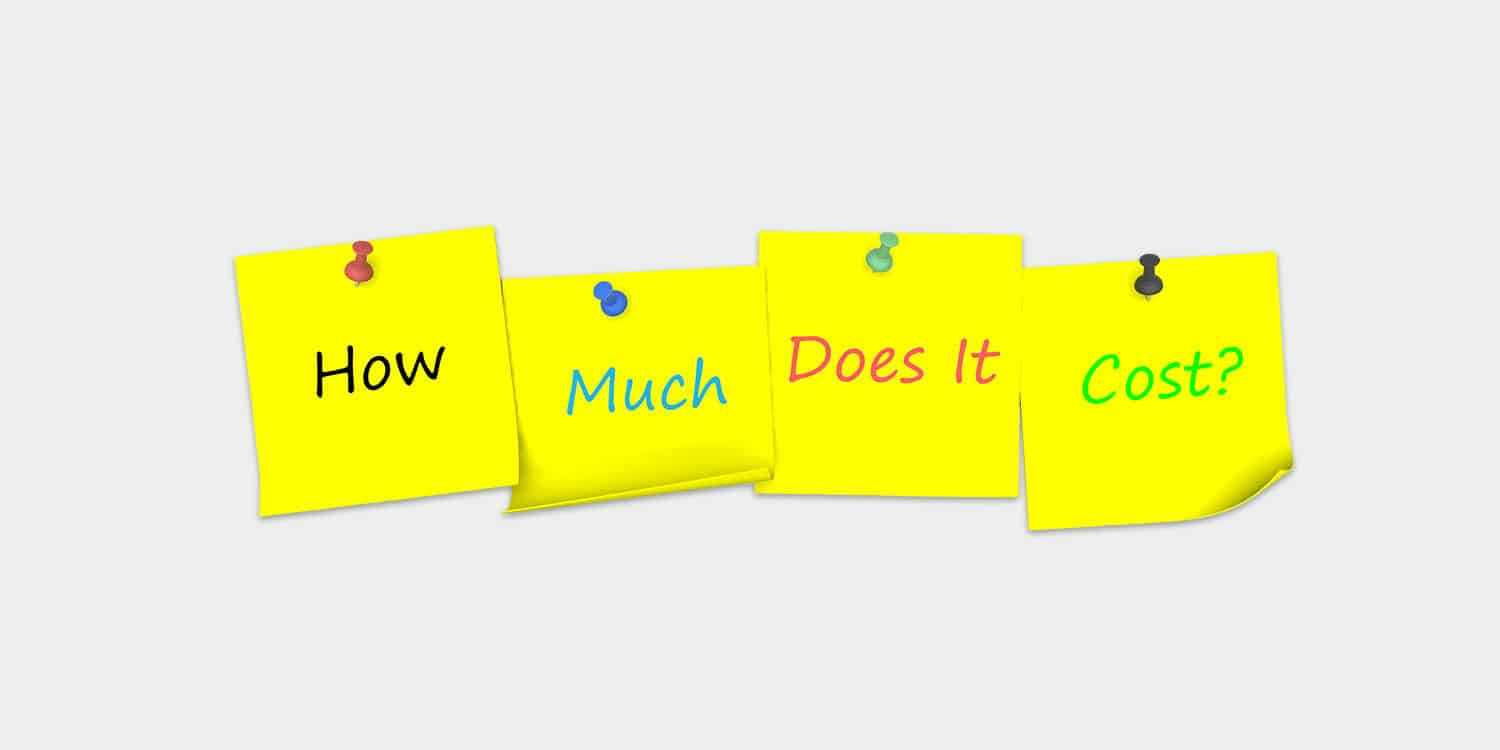 "Four yellow post-it notes against a white background, with the sentence ""How much does it cost"" written across the notes, representing the query of how much it costs to set up a company in the UK."