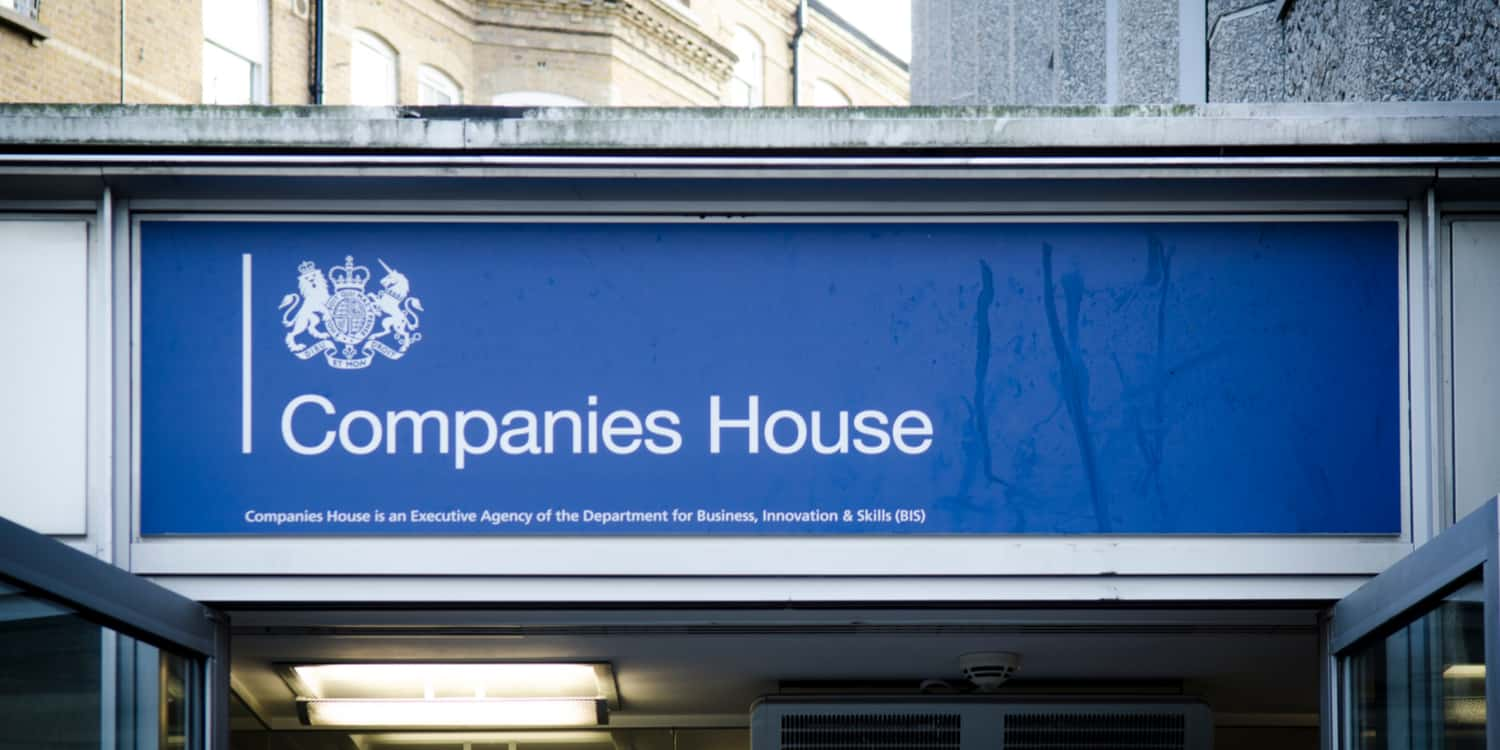 Blue sign with white lettering displaying the name 'Companies House' above Companies House Cardiff's main entrance, showing the agency where a company is required to register a charge.