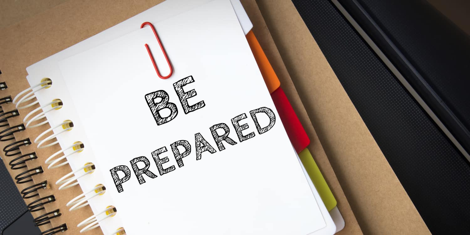 A white note pad with the phrase 'BE PREPARED' written in black ink, illustrating the importance of putting measures in place to deal with the death of a company director.