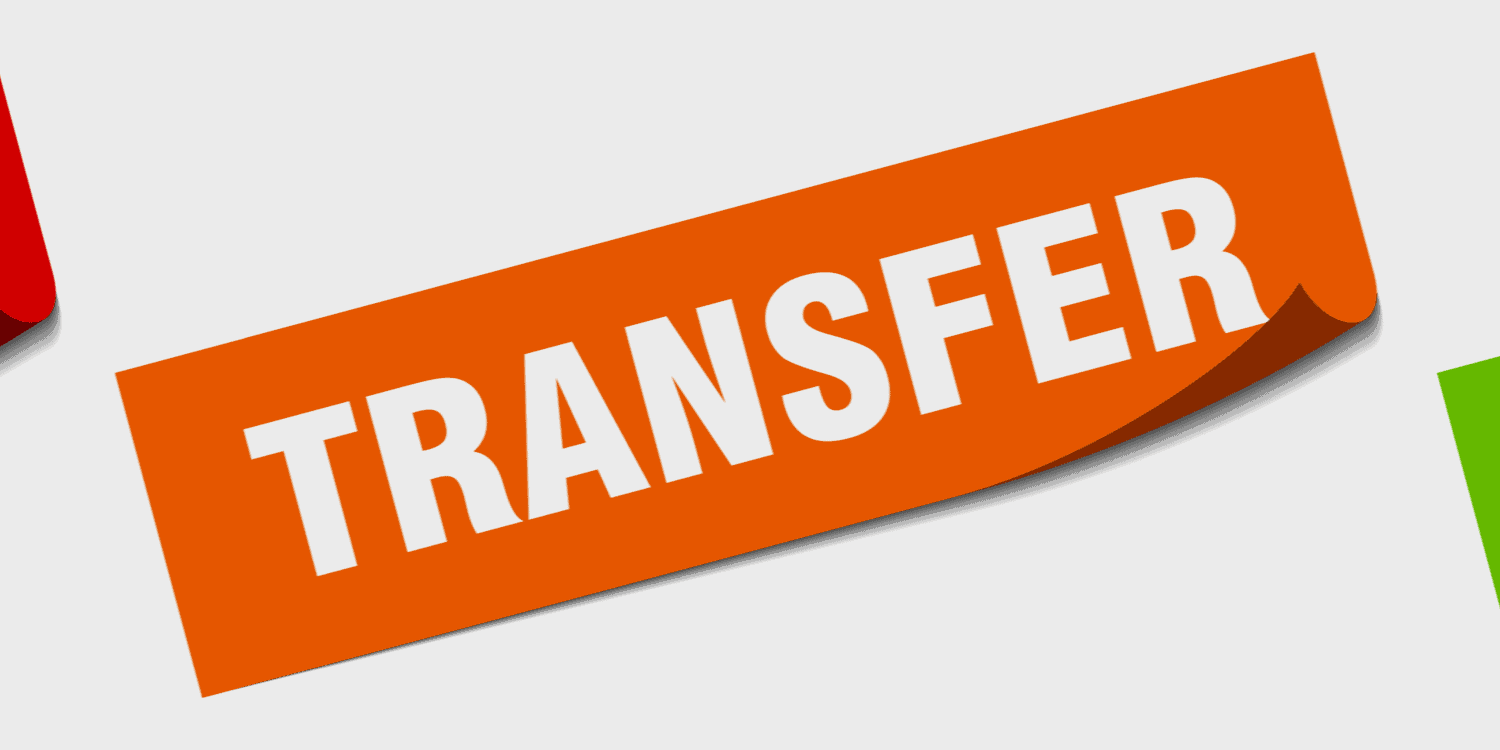 Orange sign with white letters displaying the word 'TRANSFER'.