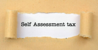'Self Assessment tax' printed in black font on white background.